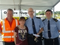 Deputy Mayor Liona O'Toole with Lucan Community Gardai at the RSA Safety event at Lucan Tesco's