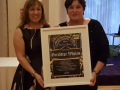 Cllr. Liona O'Toole presenting award to Geraldine Whelan at Lucan Gospel Choir event