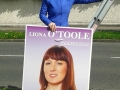 Liona O'Toole hanging election posters 2014